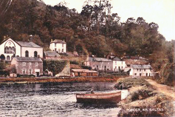 view (hand tinted) of west bank cottages etc from across the creek