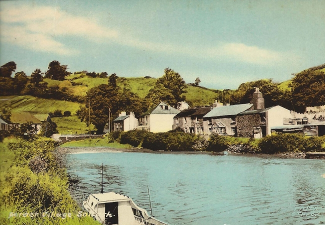 coloured postcard of east bank cottages, Forder, from across the creek